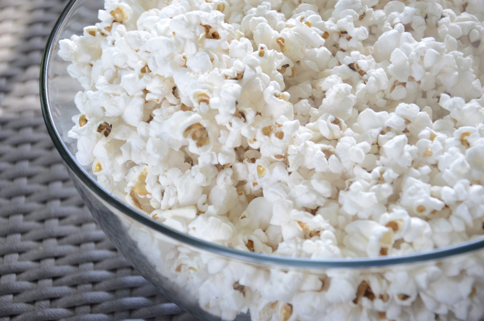 Popcorn in a large glass bowl