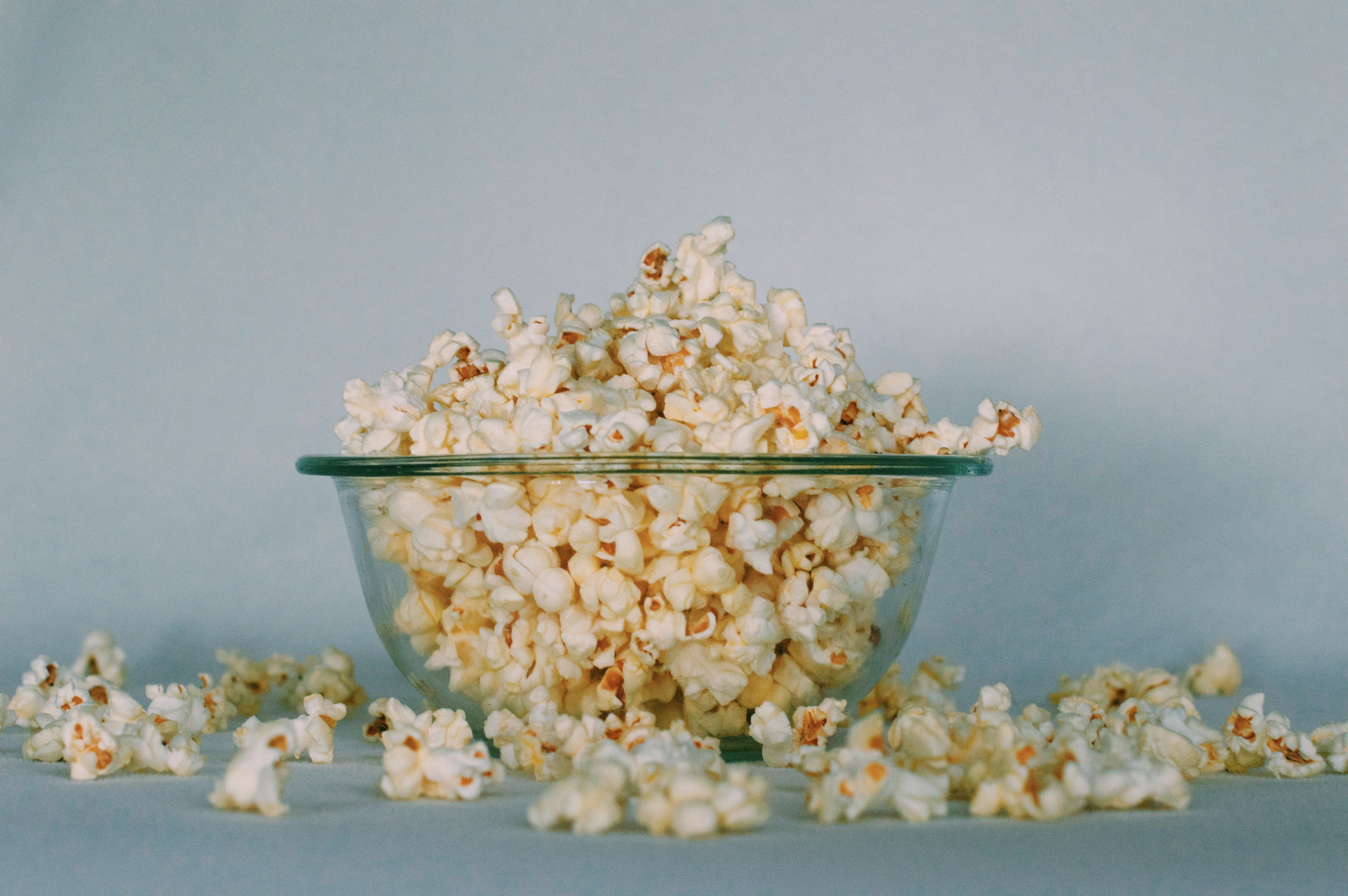 Popcorn flowing out of glass bowl