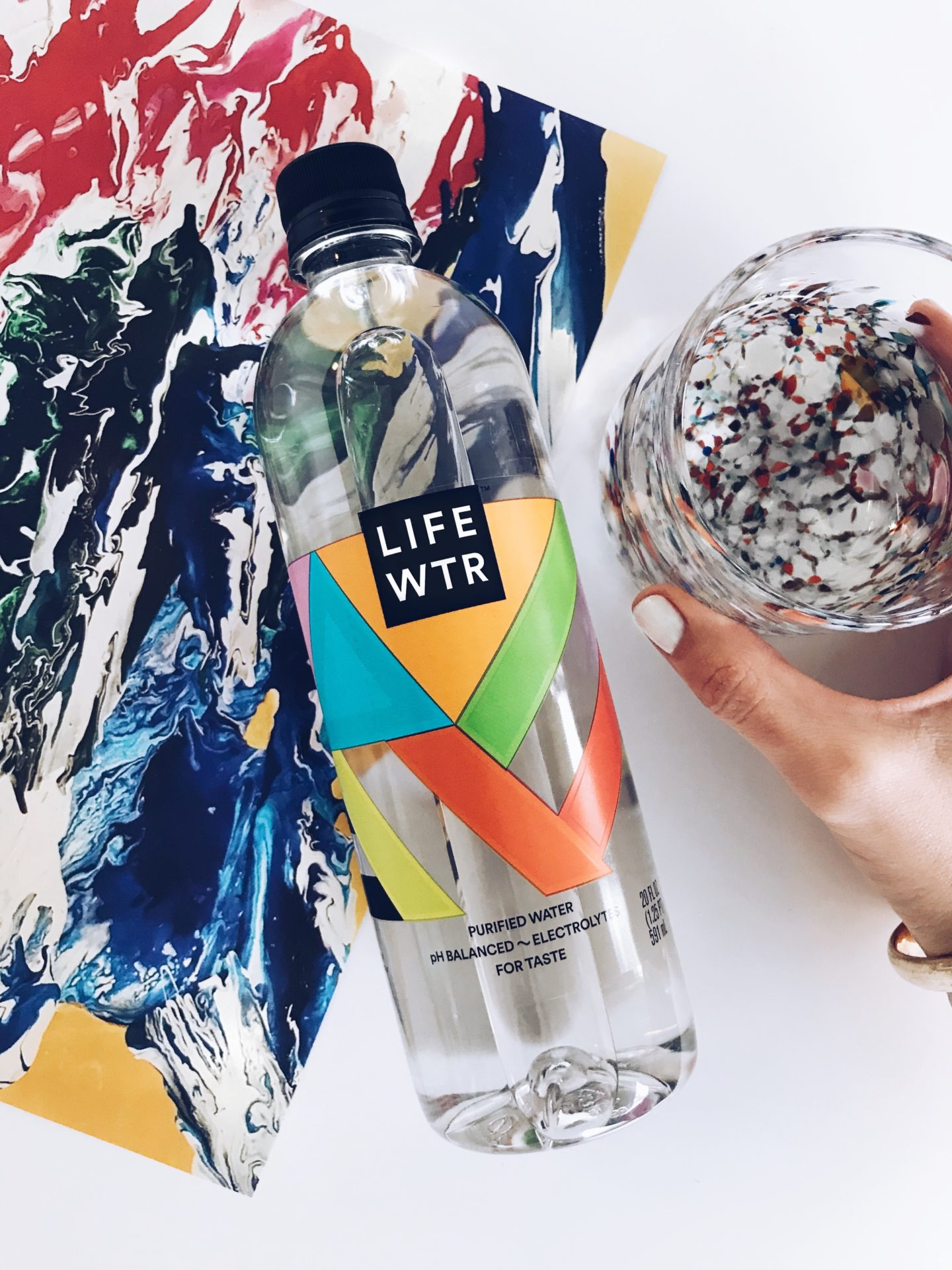 LIFEWTR with painting and glass